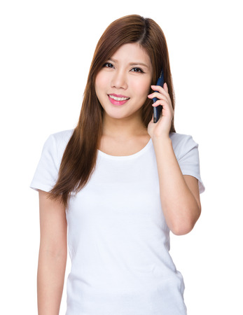 causal: Asian woman talk to mobile phone