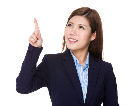 imaginary: Young businesswoman look at the finger touch on the imaginary panel