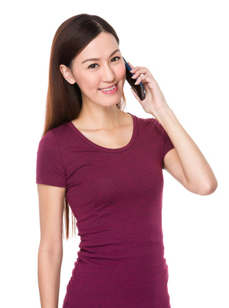 causal: Young woman talk to cellphone