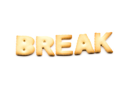 tea breaks: Word break biscuit isolated on white background Stock Photo