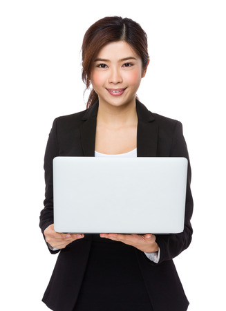 notebook computer: Businesswoman use of notebook computer Stock Photo