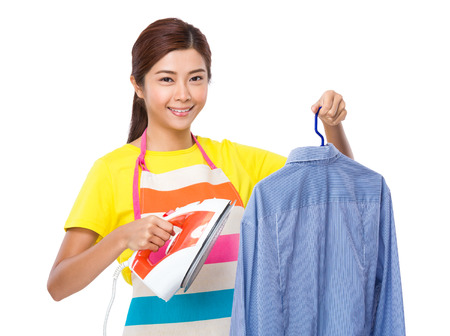 straighten: Housewife use iron for straighten of the shirt