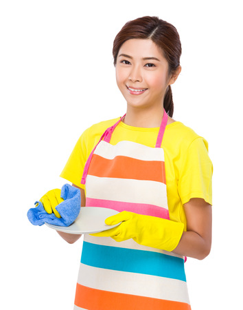 housewife gloves: Housewife wash the dishes with plastic gloves Stock Photo