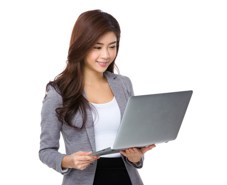 working dress: Young asian businesswoman look at notebook computer Stock Photo
