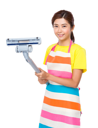 japanese cookery: Asian housewife using the vacuum