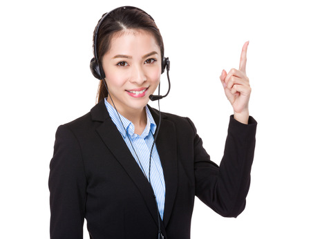 hot secretary: Customer services operator and finger point up Stock Photo