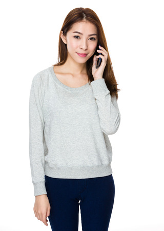 woman on phone: Woman talk to mobile phone