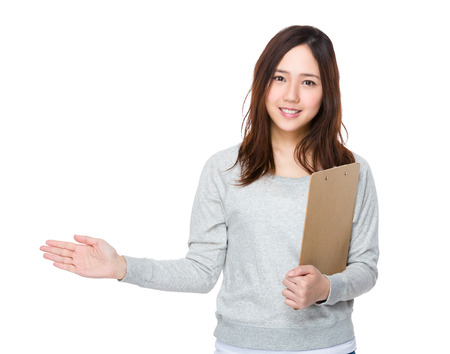 Woman hold with file and open hand palm to promote something Stock Photo