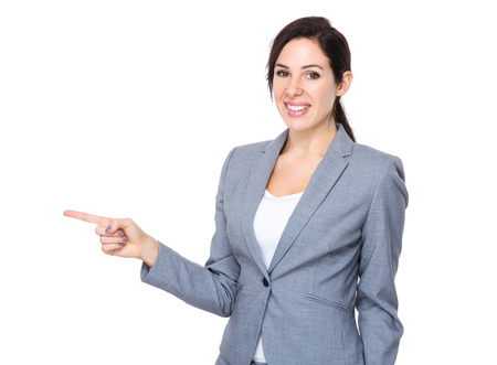 indicate: Confident businesswoman with finger indicate aside