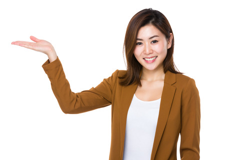 demonstrate: Young businesswoman with hand show with blank sign