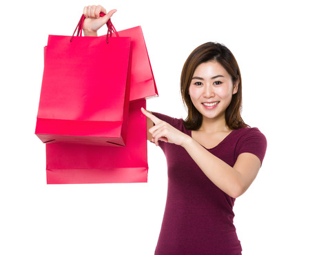 finger point: Asian woman finger point to shopping bag