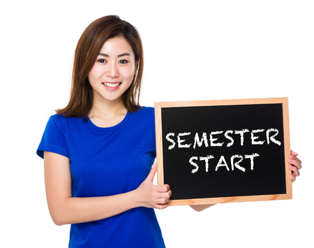 semester: Young woman with blackboard showing semester start