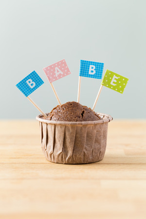 babe: Flag on muffin with a word babe