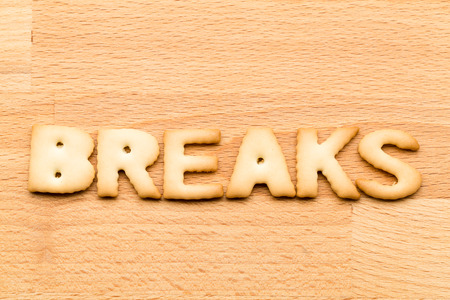 tea breaks: Word break biscuit over the wooden background Stock Photo