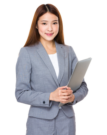 chinese american ethnicity: Young businesswoman with laptop Stock Photo