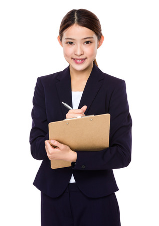 jot: Young businesswoman jot down some on clipboard Stock Photo