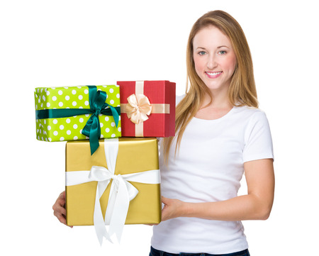 carries: Pretty woman hands many presents