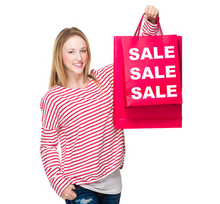 seasonal clothes: Woman hold with shopping bag and showing three sale word Stock Photo