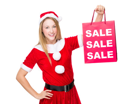 christmas shopping bag: Christmas party dressing girl with shopping bag showing three sale word Stock Photo
