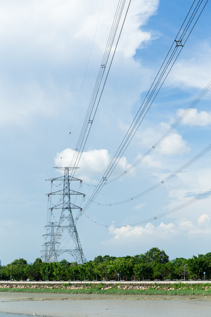 powerlines: Electrical high voltage powerlines tower Stock Photo
