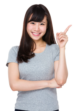 sell out: Asian Young woman with finger point up Stock Photo
