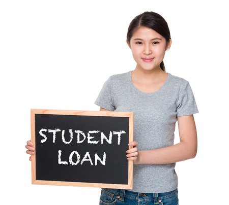 student loan: Young woman with the blackboard and showing phrase student loan