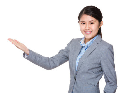 demonstrate: Young businesswoman with open hand palm