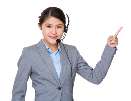 hotlink: Asian businesswoman with headset and finger point up