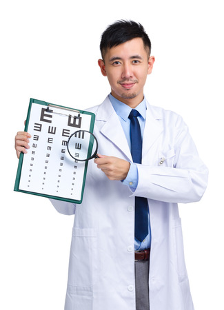 eye chart: Optician with eye chart and magnifying glasses Stock Photo
