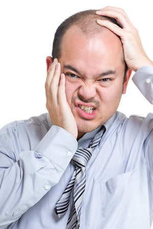 suffer: Businessman suffer from toothache and headache Stock Photo