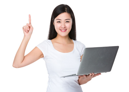 notebook computer: Woman use of notebook computer and finger point up Stock Photo