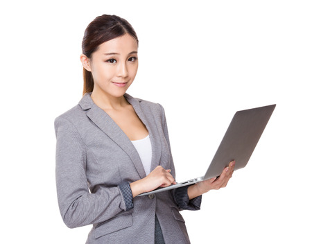 computer use: Businesswoman use of the laptop computer