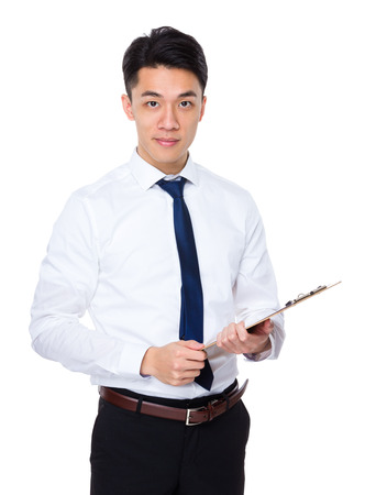 Young businessman holding with file