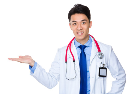 doctor holding gift: Asian doctor with open hand palm