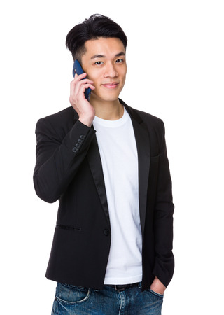 casual wear: Asian businessman talk to mobile phone