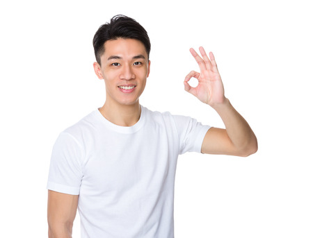 ok sign: Asian man with ok sign gesture
