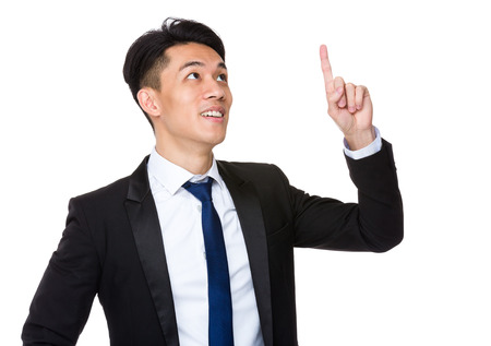 press agent: Asian businessman touch on the imaginary panel Stock Photo