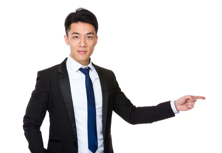 aside: Young Businessman with finger point aside