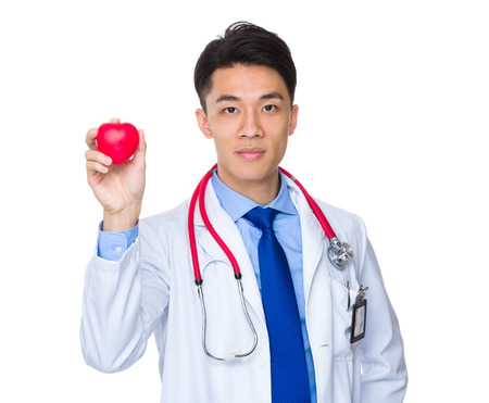 hold up: Doctor hold up with red heart ball