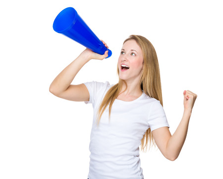 dominant woman: Woman screaming on a megaphone Stock Photo