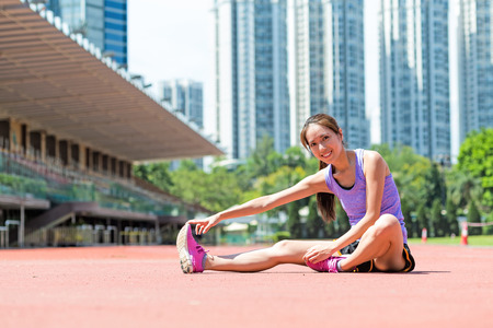 Woman do stretching exercise on legs at outdoor