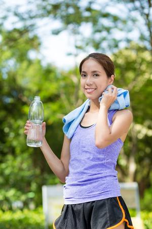 take a break: Woman take a break after sport exercise