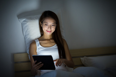 bed time: Woman checking email before bed time