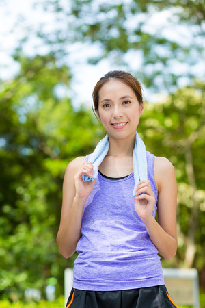 outdoor exercise: Asian woman with towel on shoulder after doing exercise