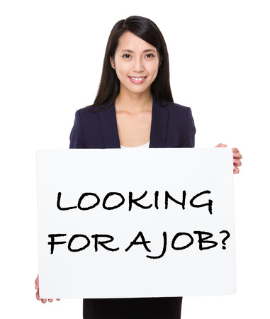 looking for job: Young businesswoman showing a placard showing with looking for a job phrases