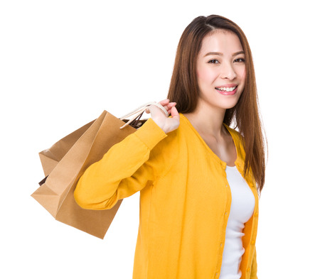 holding paper: Woman holding paper bag