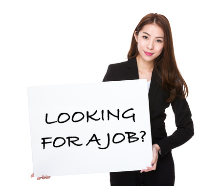 looking for job: Business woman with a board for phrase of looking for a job Stock Photo