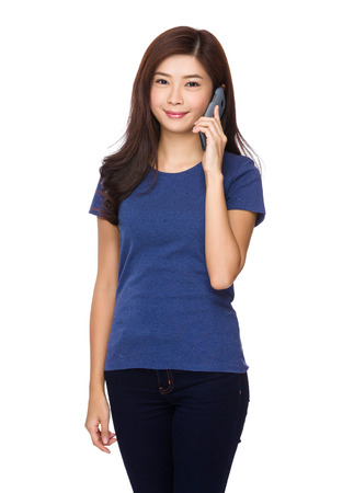 causal: Asian woman chat on cellphone Stock Photo