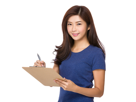 jot: Young woman jot down something on clipboard Stock Photo