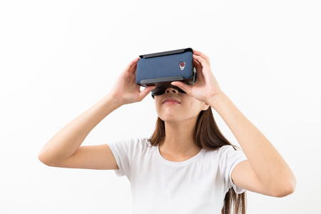 virtual classroom: Woman looking though the VR device Stock Photo